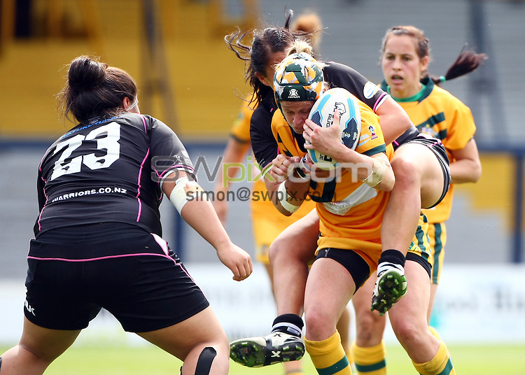 PICTURE BY VAUGHN RIDLEY/SWPIX.COM - Rugby League - Festival of World Cups, Women's Final - Australia Women v New Zealand Women - Headingley, Leeds, England - 14/07/13 - New Zealand's Charlotte Arnopp-Scanlan tackles Australia's Tahnee Norris.