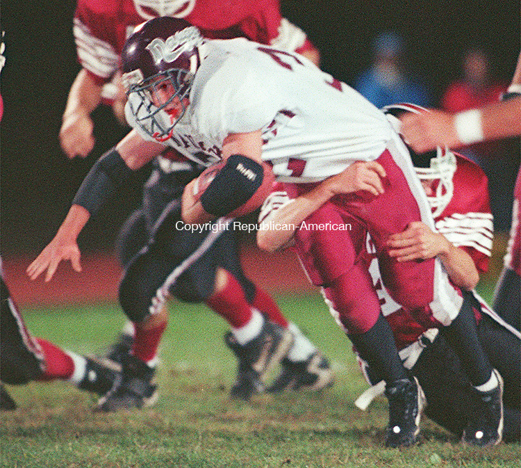 TORRINGTON,CT. 10/09/98--1009SV05.tif--#32 Kyle Wells of Naugatuck trys to break away from a Torrington defender during the NVL match up in Torrington on Friday. Steven Valenti Photo