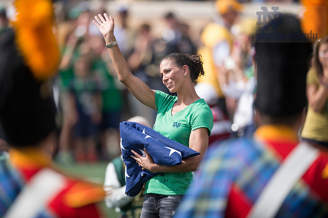 Sep 26, 2015; U.S. Women's National Soccer Team member and former Notre Dame Women's Soccer team member Shannon Boxx presents the flag before the UMass game. (Photo by Matt Cashore)