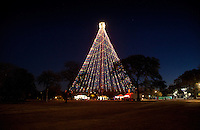 The Zilker Tree Stands 155 feet tall and is composed of 39 streamers, each holding 81 multicolored, 25 watt bulbs, totaling 3,309 lights. At the top of the tree, a double star measures 10 feet from point to point. The double star displays 150 frosted bulbs.The Zilker Tree was initiated in 1965 by Mrs. Alden (Mabel)Davis, civic leader and chairperson for the City's Special Holiday Activities Committee. The tree was designed by City of Austin electricians Odie Bull, D.J. Kozlowski, Fred Scantlen and Merle Wheeler. On December 10, 1967, the first tree was lighted by Mayor Pro Tem Mrs. Emma Long.