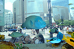 July 25th, 2011, Tokyo, Japan - Much to the amusement of tourists and pedestrians in the background, tropical fish from Okinawa, Japans southern islands, swim leisurely in the aquarium temporarily installed at the sidewalk of Tokyos bustling Ginza shopping district on Monday, July 25, 2011. The display was part of the main attraction of Sony showroom, one of the major tourists spots in the area. (Photo by Natsuki Sakai/AFLO) [3615] -mis-