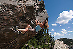 bouldering, woman on Sunspot, Chaos Canyon, sunny, day, summer, morning, Rocky Mountain National Park, Rocky Mountains, Colorado, USA