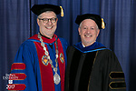 The Rev. Dennis H. Holtschneider, C.M., president of DePaul, left, and Paul Zionts, dean of the College of Education. DePaul University College of Education held its commencement ceremony, Saturday, June 10, 2017, at the Rosemont Theatre in Rosemont, IL. The Rev. Dennis H. Holtschneider, C.M., president of DePaul, conferred the degrees. (DePaul University/Jeff Carrion)