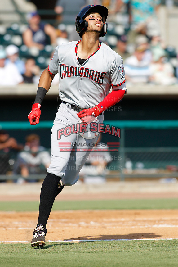 Hickory Crawdads outfielder Pedro Gonzalez (4) at bat during a game against the Charleston Riverdogs at the Joseph P. Riley Ballpark in Charleston, South Carolina.  Hickory defeated Charleston 8-7. (Robert Gurganus/Four Seam Images)