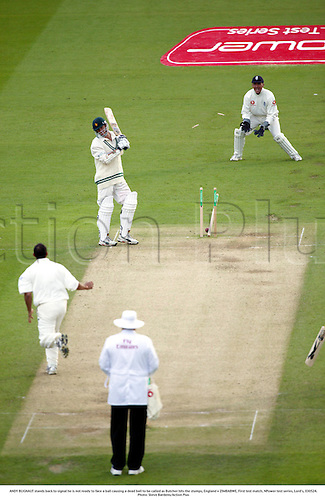 ANDY BLIGNAUT stands back to signal he is not ready to face a ball causing a dead ball to be called as Butcher hits the stumps, England v ZIMBABWE, First test match, NPower test series, Lord's, 030524. Photo: Steve Bardens/Action Plus...2003.Cricket .batsman batsmen.