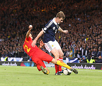 Daniel Georgievski tackles Paul Dixon in the Scotland v Macedonia FIFA World Cup Qualifying match at Hampden Park, Glasgow on 11.9.12.