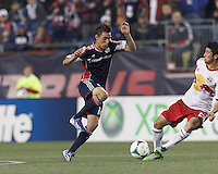 New England Revolution midfielder Diego Fagundez (14) reacts to loose ball. In a Major League Soccer (MLS) match, the New England Revolution (blue) tied New York Red Bulls (white), 1-1, at Gillette Stadium on May 11, 2013.