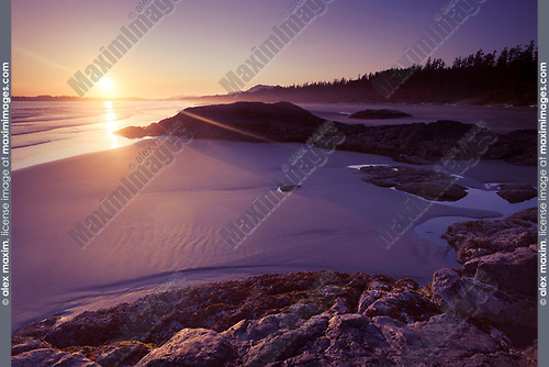 Beautiful sunset scenery of Pacific Rim National Park, Long Beach at Green Point at low tide. Pacific ocean shore in Tofino, Vancouver Island, BC, Canada. Image © MaximImages, License at https://www.maximimages.com