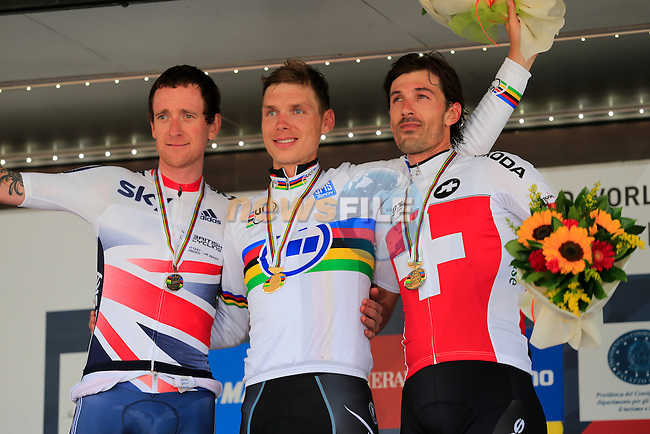 Tony Martin (GER) wins the gold medal, Sir Bradley Wiggins (GBR) takes the silver medal and Fabian Cancellara (SUI) takes the bronze medal in the Mens Individual Time Trial at the 2013 UCI World Championships held over a 58km course in Tuscany finishing in the city of Florence, Italy. 23rd September 2013.<br /> (Photo:Eoin Clarke/www.newsfile.ie)