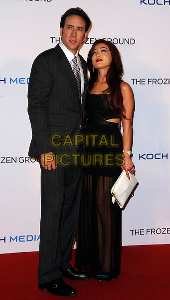 Nicolas Cage &amp; Alice Kim Cage<br /> 'The Frozen Ground' UK film premiere, Vue West End cinema, Leicester Square, London, England.<br /> 17th July 2013<br /> full length sheer dress black married husband wife white clutch bag white shirt purple suit grey gray suit pinstripe<br /> CAP/DS<br /> &copy;Dudley Smith/Capital Pictures