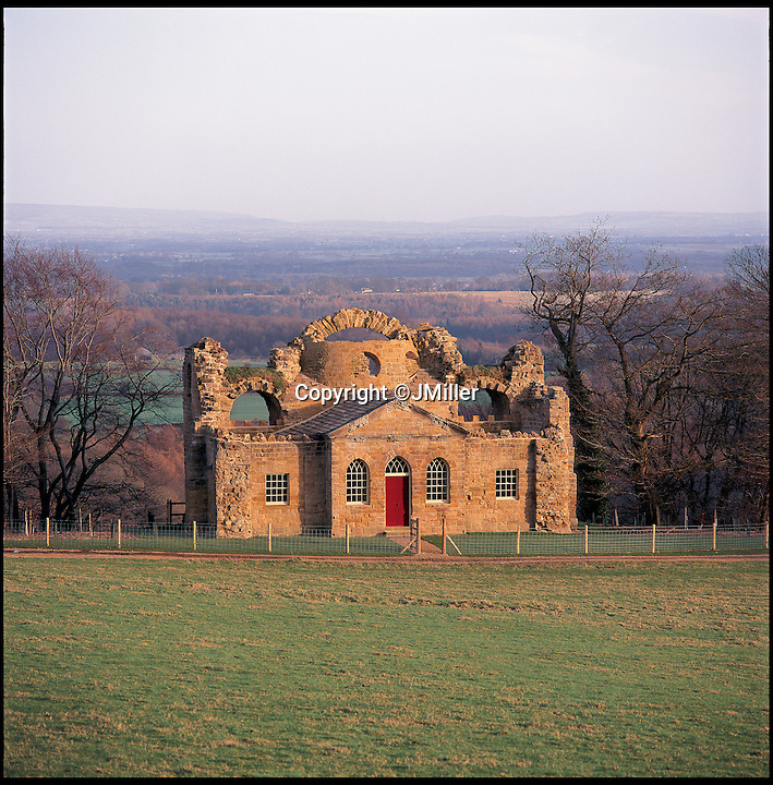 BNPS.co.uk (01202 558833)<br /> Pic: LandmarkTrust/BNPS<br /> <br /> The Ruin, in, North Yorkshire. <br /> <br /> Fully booked...Holidays less ordinary spark a booking frenzy in Brits.<br /> <br /> A charity which rents out historic buildings around Britain is celebrating a boom in business that has seen some of its properties booked out years in advance.<br /> <br /> The Landmark Trust has transformed almost 200 of the country's quirkiest buildings - from medieval castles to Tudor towers and even a former pig sty - into unique holiday homes.<br /> <br /> And they have become so popular with Brits looking for unusual places to escape to that some buildings are fully booked until 2016.<br /> <br /> Top of the most popular properties are Luttrell's Tower, a Georgian folly near Southampton, Hants, and Astley Castle, a Saxon stronghold dating back to the 12th century in Nuneaton, Warks.<br /> <br /> Other favourites include a Victorian pigsty near Whitby, North Yorks, which was built in the style of a Greek temple, and the London townhouse of 20th century poet John Betjeman.<br /> <br /> The buildings have become such a hit among holidaymakers that they are willing to fork out thousands of pounds to stay in them.<br /> <br /> While prices start at 10 pounds a night for cosy cottages in winter, a seven-night stay at the most popular properties in the height of summer can cost up to 3,000 pounds.<br /> <br /> But the fees are then ploughed back into the upkeep and restoration of the properties.