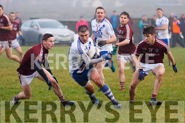 St Marys Daniel Daly showing true determination comes through two Dromid players Pádraig Ó Súilleabhain and Kealan Ó Faircheallaigh and finishes with a well taken kick adding another point for the Marys.