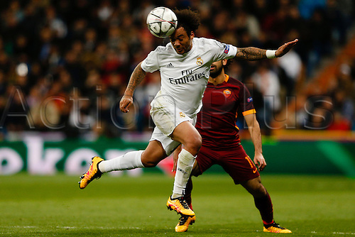 08.03.2016 Estadio Santiago Bernabeu, Madrid, Spain. UEFA Champions League Real Madrid CF versus AS Roma.  Marcelo Viera da Silva (12) Real Madrid and Mohamed Salah (11) Roma challenge for the headed ball.