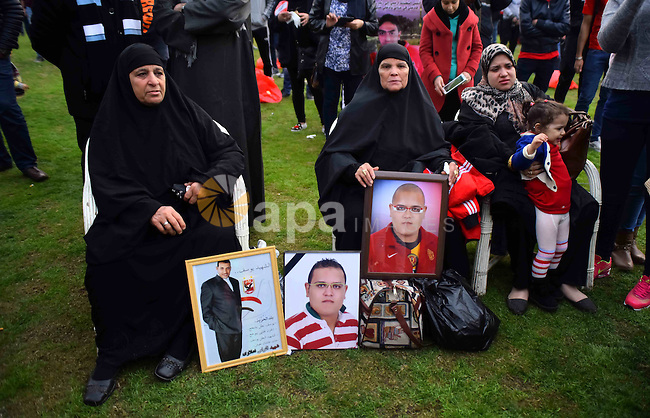 "Relatives of al-Ahly fans, who were killed in what known as the ""Port Said massacre"", attend the fourth anniversary of killing their relatives at al-Ahly club's training stadium, on February 1, 2016. On 1 February 2012, a massive riot occurred at Port Said Stadium in Port Said city, Egypt, following an Egyptian Premier League football match between El Masry and El Ahly clubs. At least 74 people were killed and more than 500 were injured after thousands of El Masry spectators stormed the stadium stands and the pitch. Photo by Amr Sayed"