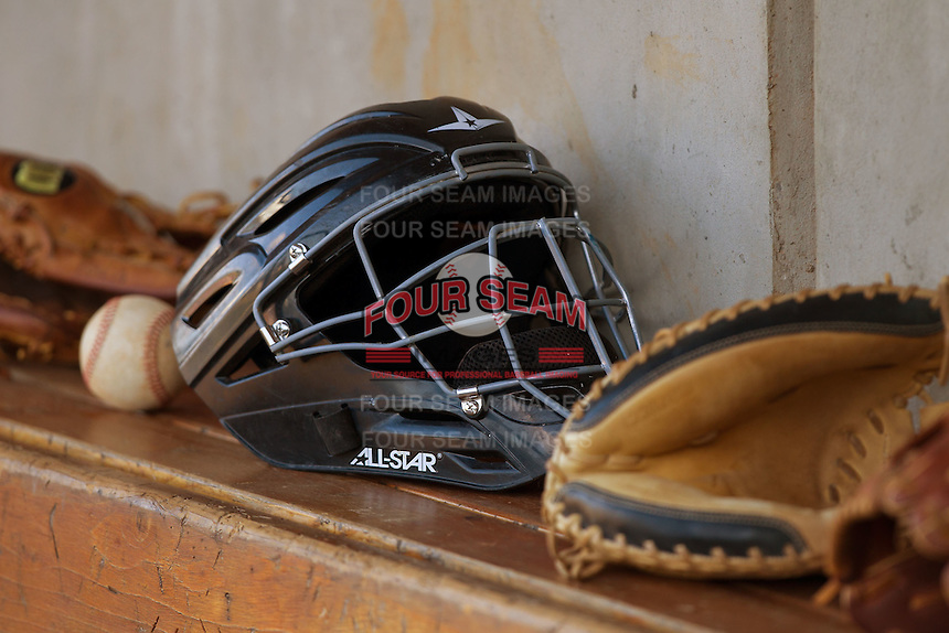 Catchers equipment sits in the home dugout prior to the Carolina League game between the Lynchburg Hillcats and the Winston-Salem Dash at BB&T Ballpark on August 13, 2014 in Winston-Salem, North Carolina.  The Hillcats defeated the Dash 4-3.   (Brian Westerholt/Four Seam Images)