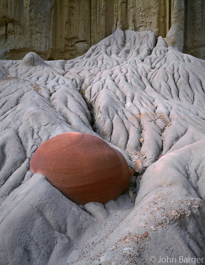NDTR_108 - USA, North Dakota, Theodore Roosevelt National Park, An erosion-resistant concretion is exposed as surrounding softer sediments weather away, Cannonball Concretion Area, North Unit.