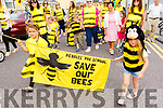 Little Cora Corridan and Doireann Ferris holding the Bumble Bee flag at the Ballyheigue Summer Fest Parade on Sunday