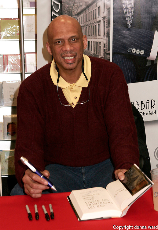 """NEW YORK - JANUARY 30: Basketball legend Kareem-Abdul Jabar poses before signing his book """"On The Shoulders of Giants"""" at Borders Bookstore in midtown on January 30, 2007 in New York City."""