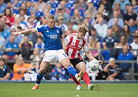 Denver Hume of Sunderland clears under pressure from Danny Rowe of Ipswich Town during Ipswich Town vs Sunderland AFC, Sky Bet EFL League 1 Football at Portman Road on 10th August 2019