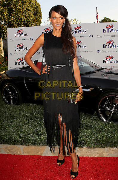 "Judi Shekoni.7th Annual BritWeek Festival ""A Salute To Old Hollywood"" Launch Party held at the British Consul General's Residence, Los Angeles, California, USA..April 23rd, 2013.full length black sleeveless dress clutch bag silver hand on hip.CAP/ADM/KB.©Kevan Brooks/AdMedia/Capital Pictures"