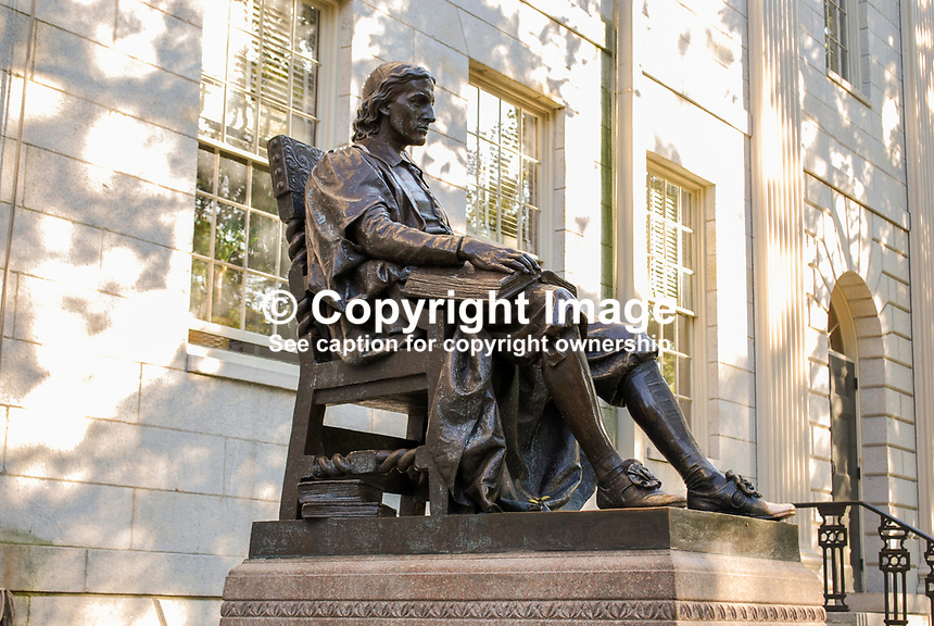 John Harvard Statue at Harvard University, Boston, Massaschussets, USA.  It is also known as the Statue of Three Lies. The face is fictional as no original picture or statue of him survives. He was not the founder but the university's bit its first benefactor. The inscription says Harvard was founded in 1638; it was actually founded two years earlier. 201110074952..Copyright Image from Victor Patterson, 54 Dorchester Park, Belfast, United Kingdom, UK...For my Terms and Conditions of Use go to http://www.victorpatterson.com/Victor_Patterson/Terms_%26_Conditions.html