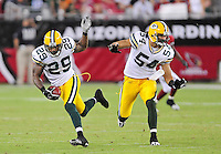 Aug. 28, 2009; Glendale, AZ, USA; Green Bay Packers safety (29) Anthony Smith intercepts a pass as linebacker (54) Brandon Chillar defends against the Arizona Cardinals during a preseason game at University of Phoenix Stadium. Mandatory Credit: Mark J. Rebilas-