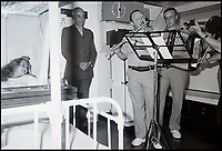 BNPS.co.uk (01202 558833)<br /> Pic: RYBritannia/BNPS<br /> <br /> Wren Julie McPherson is serenaded by the Queens musicians in the RY Britannia's sickbay back in 1992.<br /> <br /> A navy wren who made history when she was transferred to Royal Yacht Britannia for emergency treatment in its sick bay has told how she was pampered by the Queen.<br /> <br /> Her Majesty and Prince Philip visited Julie Harding on her sick bed, arranged for the Royal band to play to her and showered her with gifts and food after she unexpectedly interrupted their summer cruise in 1992.<br /> <br /> The 18-year-old wren was serving on HMS Brilliant which was escorting Britannia around the Western Isles of Scotland when she suffered a gruesome injury to her fingers in an accident on board.<br /> <br /> Due to a lack of medical resources on the Royal Navy frigate, Mrs Harding was transferred to the Royal yacht so she could be operated on by the Queen's doctors.<br /> <br /> Mrs Harding has returned to Britannia, now a floating museum at Leith, to be reunited with the medics who treated her to mark the 25th anniversary of the event.