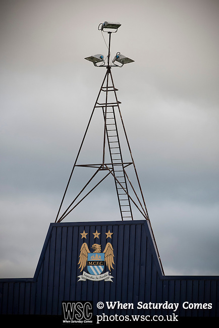Hyde 1 Stalybridge Celtic 1, 26/12/2011. Ewen Fields, Conference North. The Manchester City crest which adorns the main stand at Ewen Fields, Hyde, pictured before Hyde take on Stalybridge Celtic in a Conference North fixture. The match, between the teams occupying the top two places in the division, ended one-all in front of 1868 spectators, Hyde's largest home attendance in 15 years. Ewen Fields is used by Manchester City reserves for matches and has been rebranded in city's colours and with their sponsors advertising around the ground, with the club changing its name from Hyde United to the present one. Photo by Colin McPherson.