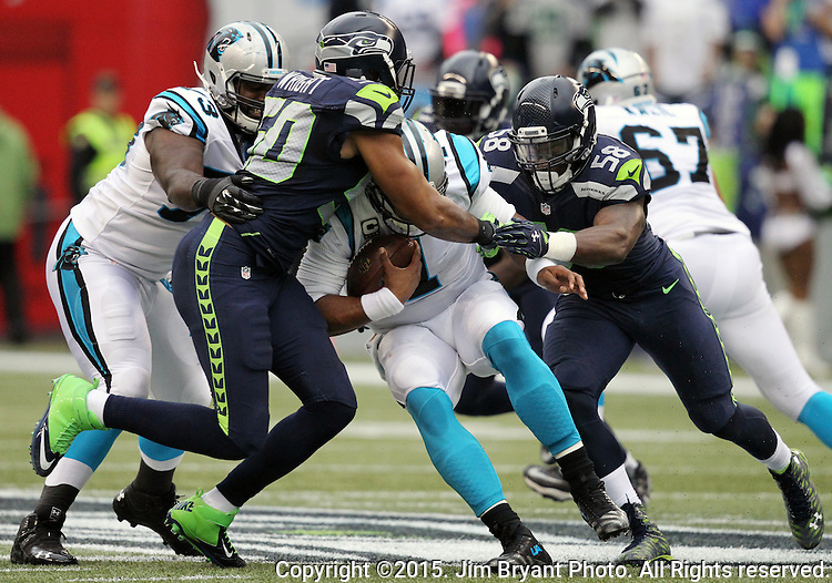 Seattle Seahawks  linebackers K.J. Wright (50) and Kevin Pierre-Louis (58) close in on Carolina Panthers quarterback Kam Newton (1) at CenturyLink Field in Seattle on October 18, 2015. The Panthers came from behind with 32 seconds remaining in the 4th Quarter to beat the Seahawks 27-23.  ©2015 Jim Bryant Photography. All Rights Reserved.