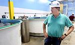 WATERBURY CT. 23 June 2017-062317SV05-Eric Pedersen, president, looks over fish tanks at Great American Aquaculture in Waterbury Friday. <br /> Steven Valenti Republican-American