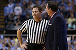 24 February 2015: Referee Raymond Styons listens to NC State head coach Mark Gottfried (right). The University of North Carolina Tar Heels played the North Carolina State University Wolfpack in an NCAA Division I Men's basketball game at the Dean E. Smith Center in Chapel Hill, North Carolina. NC State won the game 58-46.