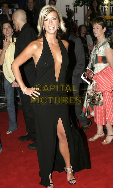"CAROLINE FARRADY.""King Arthur"" UK Premiere, Leicester Square. London,.15th July 2004..full length low cut plunging neckline black dress diamante shoes.Ref: AH.www.capitalpictures.com.sales@capitalpictures.com.©Capital Pictures."