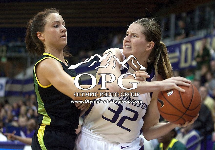 7 March 2010:  Washington Huskies guard #32 Sami Whitcomb looks for an open teammate to pass the ball to while being guarded against Oregon's #1 Taylor Lilley. Washington won 62-53 over Oregon at the Bank of America Arena in Seattle, WA.