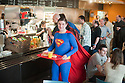 Kapow Comic convention in London today 10.4.11.People dressed as various character from comics and sci fi films attend the convention ..Pic shows:  Paul Nurse a charity treasurer from London queue for lunch of orange and a cheese baguette in the canteen dressed a Superman......pic by Gavin Rodgers/ Pixel 8000.07917221968