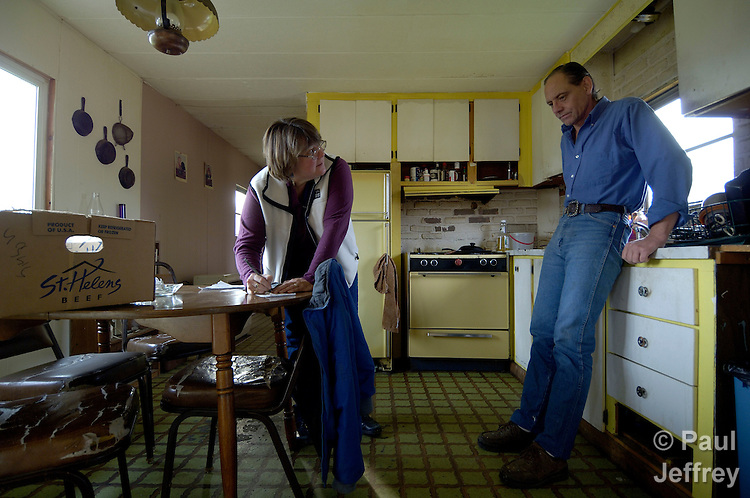 Fran Lynch in a United Methodist deaconess in Willow, Alaska, involved in a variety of ministries with people in the region. Here she talks with Robert Sisson, taking a new food order that she'll shop for and deliver to his house.