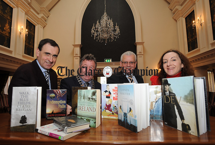 Ger Dollard, Director of Sevices Clare County Council and Ennis Town manager, Michael Guilfoyle, Deputy Mayor and county manager Tom Coughlan with Helen Walsh, Clare county librarian at the launch of the Ennis Book Club Festival which runs from 5th to 7th March. Photograph by John Kelly.
