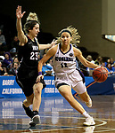 SIOUX FALLS, SD - MARCH 19: Kelly Martin #12 from Stonehill looks to get step past Halle Denman #23 from Indiana (PA) during their quarterfinal game at the 2018 Elite Eight Women's NCAA DII Basketball Championship at the Sanford Pentagon in Sioux Falls, SD. (Photo by Dave Eggen/Inertia)