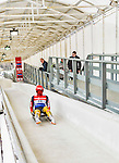 5 December 2014: Julian von Schleinitz, sliding for Germany, crosses the finish line on his first run, ending the day with a 23rd place finish and a combined 2-run time of 1:44.714 in the Men's Competition at the Viessmann Luge World Cup, at the Olympic Sports Track in Lake Placid, New York, USA. Mandatory Credit: Ed Wolfstein Photo *** RAW (NEF) Image File Available ***