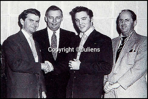 """BNPS.co.uk (01202 558833)<br /> Pic BNPS<br /> <br /> Elvis shakes hands with Sam Philips of Sun Records after signing to RCA for £35,000 in 1955 - New manager Col Parker is on the right.<br /> <br /> In black and white - the winners and losers from the birth of Rock n Roll.<br /> <br /> Never-seen-before letters charting the struggles a record producer had in launching an unknown Elvis Presley into the music world have emerged for sale for £50,000.<br /> <br /> The fascinating archive reveals calamitous calls made by record executives and DJs who rejected Memphis music impresario Sam Phillips' efforts to get Elvis' name out there.<br /> <br /> Mr Phillips, boss of the fledgling star's first record label Sun Records, wrote: """"Sun has released a new artist who is creating a tremendous excitement...his name is Elvis Presley.""""<br /> <br /> The archive of 47 letters includes several rejection letters and is being sold by Henry Aldridge and Son of Devizes, Wilts."""