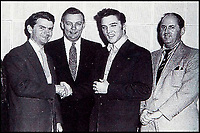 "BNPS.co.uk (01202 558833)<br /> Pic BNPS<br /> <br /> Elvis shakes hands with Sam Philips of Sun Records after signing to RCA for £35,000 in 1955 - New manager Col Parker is on the right.<br /> <br /> In black and white - the winners and losers from the birth of Rock n Roll.<br /> <br /> Never-seen-before letters charting the struggles a record producer had in launching an unknown Elvis Presley into the music world have emerged for sale for £50,000.<br /> <br /> The fascinating archive reveals calamitous calls made by record executives and DJs who rejected Memphis music impresario Sam Phillips' efforts to get Elvis' name out there.<br /> <br /> Mr Phillips, boss of the fledgling star's first record label Sun Records, wrote: ""Sun has released a new artist who is creating a tremendous excitement...his name is Elvis Presley.""<br /> <br /> The archive of 47 letters includes several rejection letters and is being sold by Henry Aldridge and Son of Devizes, Wilts."
