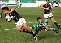Manawatu firstfive Aaron Cruden ankletaps Alapati Leiua during the Air NZ Cup preseason match between Manawatu Turbos and Wellington Lions at FMG Stadium, Palmerston North, New Zealand on Friday, 17 July 2009. Photo: Dave Lintott / lintottphoto.co.nz