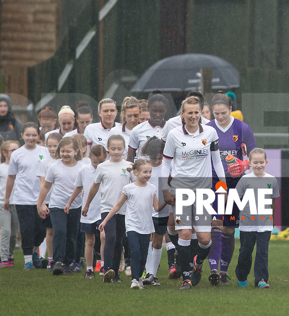 Anneka Nuttall of Watford Ladies & her team head out with young mascots ahead of the FAWSL2 match between Watford Ladies and Durham Women at Gaywood Park, Hempstead Road, England on 12 March 2017. Photo by Andy Rowland.