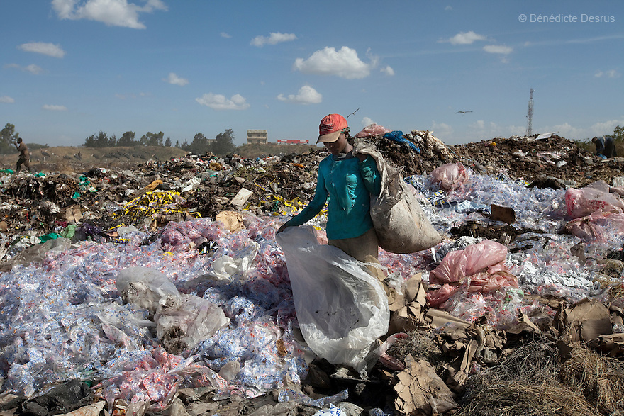 13 february 2013 - Dandora dumpsite, Nairobi, Kenya - A Kenyan woman searches through trash at the Dandora dumpsite, one of the largest and most toxic in Africa. Located near slums in the east of the Kenyan capital Nairobi, the open dump site was created in 1975 and covers 30 acres. The site receives 2,000 tonnes of unfiltered garbage daily, including hazardous chemical and hospital wastes. It is a source of survival for many people living in the surrounding slums, however it also harms children and adults' health in the area and pollutes the Kenyan capital. Photo credit: Benedicte Desrus