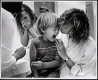 A four year-old boy gets a shot at a clinic in Whittier, Calif prior to starting kindergarten. His sister can hardly look. This picture won an Associated Press APNEC award. (Alan Greth)