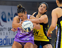 Maia Wilson takes a pass under pressure from Sulu Fitzpatrick during the 2019 ANZ Premiership netball final match between the Central Pulse and Northern Stars at Te Rauparaha Arena in Wellington, New Zealand on Monday, 3 June 2019. Photo: Dave Lintott / lintottphoto.co.nz