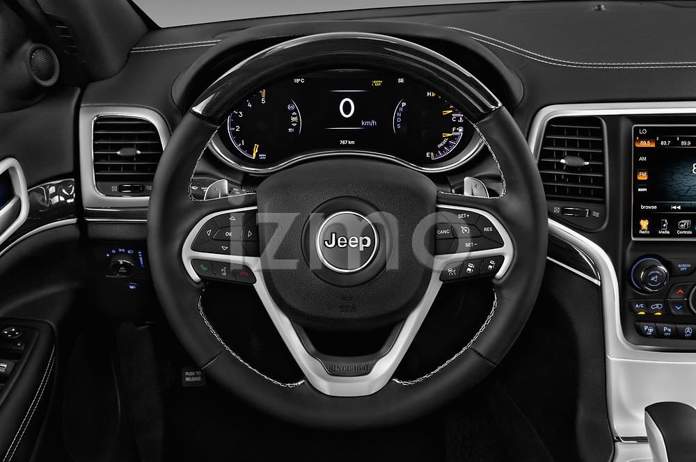 Car pictures of steering wheel view of a 2018 JEEP Grand-Cherokee Overland 5 Door SUV Steering Wheel