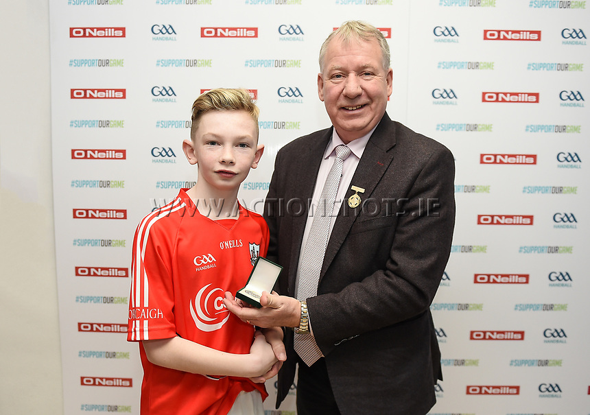 19/03/2018; 40x20 All Ireland Juvenile Championships Finals 2018; Kingscourt, Co Cavan;<br /> Boys Under-14 Singles; Galway (Mikey Kelly) v Cork (Hayden Supple)<br /> Hayden Supple is presented with his runners-up medal by GAA Handball President Joe Masterson.<br /> Photo Credit: actionshots.ie/Tommy Grealy