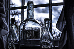 Vintage bottles on a window sill. Editing and a dreary November day added gloominess to the image.