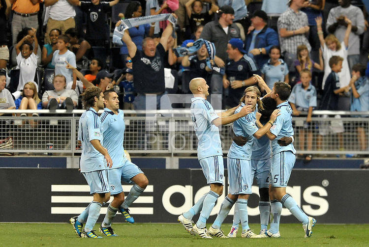 Sporting KC players celebrate their go ahead goal... Sporting Kansas City defeated Columbus Crew 2-1 at LIVESTRONG Sporting Park, Kansas City, Kansas.