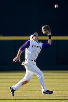 Left fielder Cameron Freeman #5 of the East Carolina Pirates tracks down a fly ball at Clark-LeClair Stadium on February 19, 2010 in Greenville, North Carolina.   Photo by Brian Westerholt / Four Seam Images